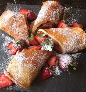 PUFFED PANCAKE ROLLED WITH STRAWBERRIES