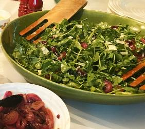 SUSAN DEVINS' ARUGULA SALAD WITH CANDIED RED ONIONS, PARM AND PINENUTS