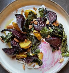 ROASTED BEETS WITH THEIR GREENS OVER LABNEH